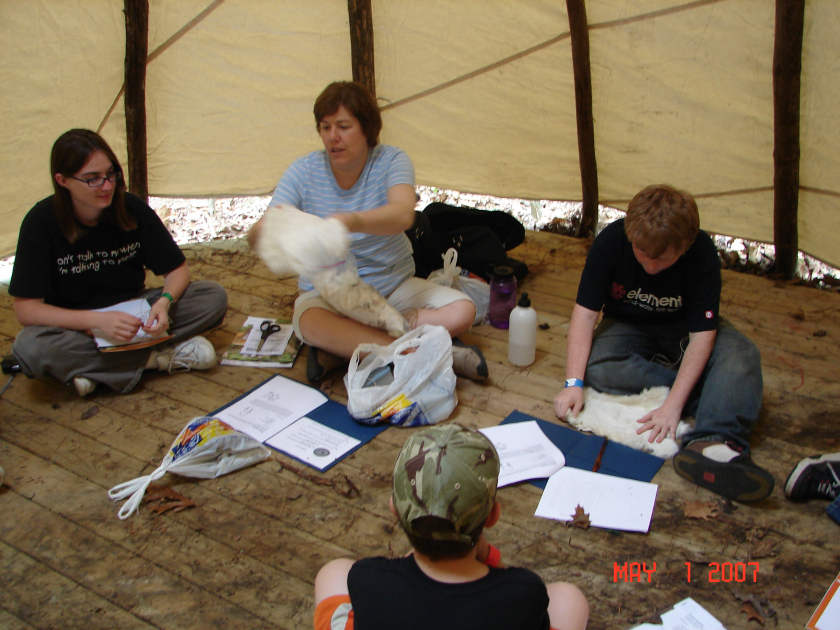 Indian Lore honor class being taught inside a teepee.