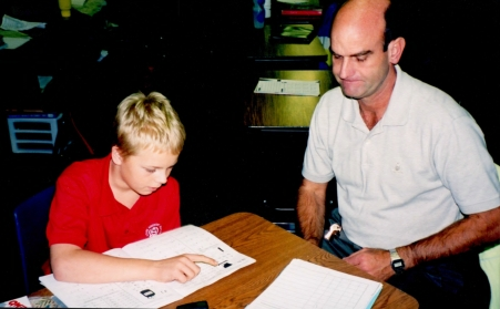 Stephen Burton helping a student